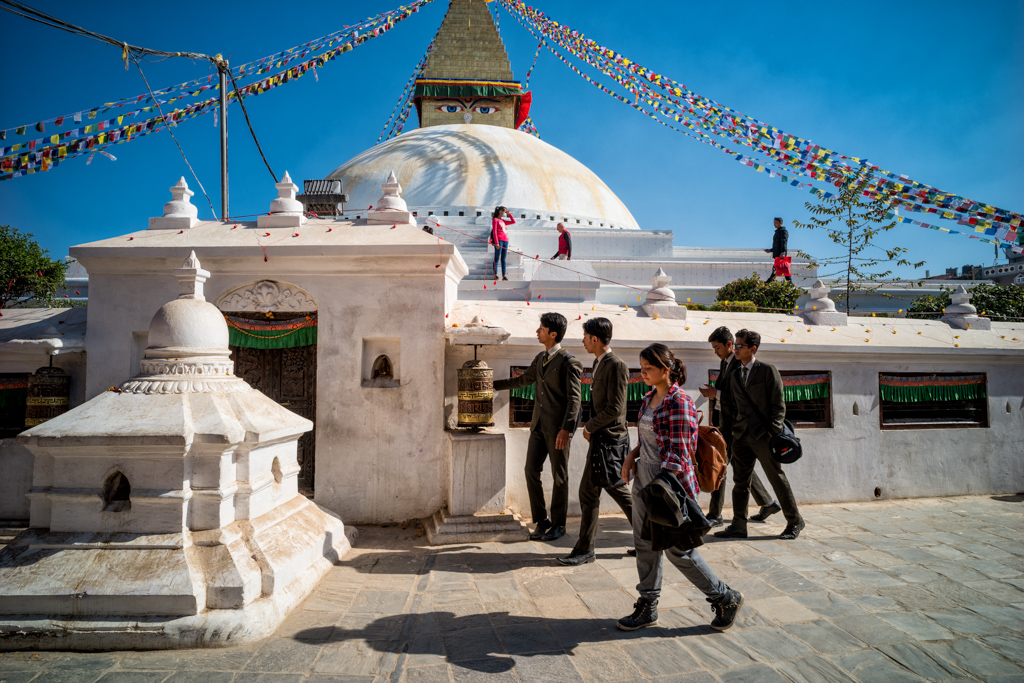 Kathmandu, Nepal, december 7th 2016: students walk around temple